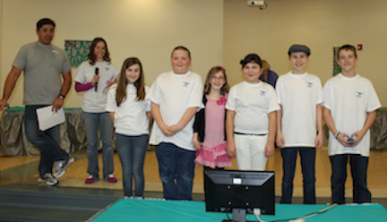 Elementary students pose after winning the Technology Challenge!